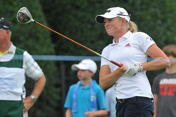 Stacy Lewis watches her drive off the 18th tee Wednesday, June 25, 2014 as she participates in the Pro-Am round of the Walmart NW Arkansas Championship at Pinnacle Country Club in Rogers.