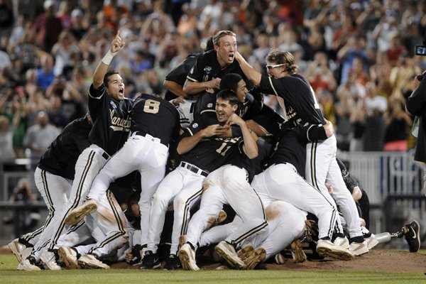 Vanderbilt players celebrate after Vanderbilt defeated Virginia 3-2 in the deciding game of the best-of-three NCAA baseball College World Series finals in Omaha, Neb., Wednesday, June 25, 2014. (AP Photo/Eric Francis)