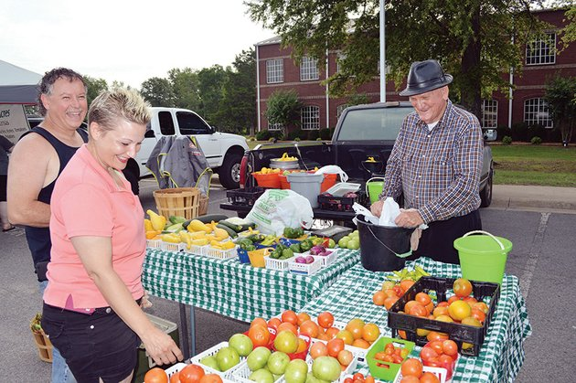 michelle-and-mark-deavers-of-conway-share-a-laugh-with-farmer-jimmy-noland-of-conway-as-they-look-over-his-produce-at-the-conway-farmers-market-the-market-which-has-been-operating-for-about-40-years-is-held-each-tuesday-and-saturday-in-the-antioch-baptist-church-parking-lot-at-150-amity-road