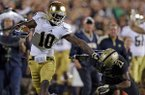In this Sept. 14, 2013 file photo, Notre Dame wide receiver DaVaris Daniels, left, pushes off Purdue cornerback Ricardo Allen on his way to an 82-yard touchdown during the second half of an NCAA college football game in West Lafayette, Ind.