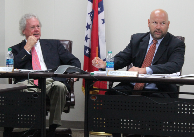 arkansas-scholarship-lottery-director-bishop-woosley-right-speaks-while-lottery-commissioner-john-c-campbell-iii-looks-on-during-a-meeting-wednesday