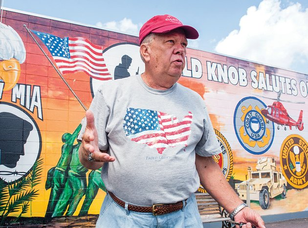 travis-case-talks-about-plans-to-do-more-with-the-veterans-memorial-in-bald-knob-as-he-stands-in-front-of-a-mural-that-salutes-all-branches-of-the-service