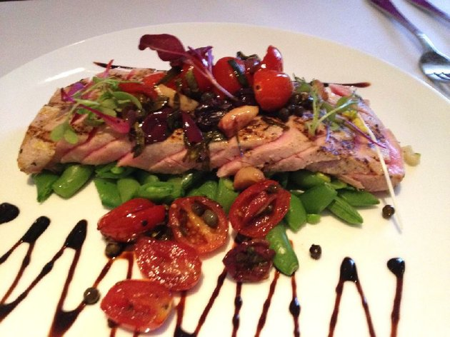 the-grilled-tuna-loin-nicoise-comes-with-a-pear-tomato-roasted-garlic-salsa-at-1620-savoy