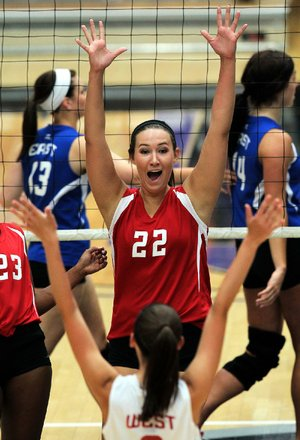 Shiloh Christian's Brittany Butler of the West All-Stars celebrates a point during Wednesday night's volleyball game.