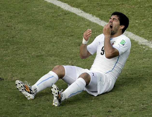 in-this-june-24-2014-file-photo-uruguays-luis-suarez-reacts-on-the-pitch-during-the-group-d-world-cup-soccer-match-between-italy-and-uruguay-at-the-arena-das-dunas-in-natal-brazil-on-thursday-june-26-2014-fifa-banned-suarez-for-9-games-and-4-months-for-biting-his-opponent-at-the-world-cup