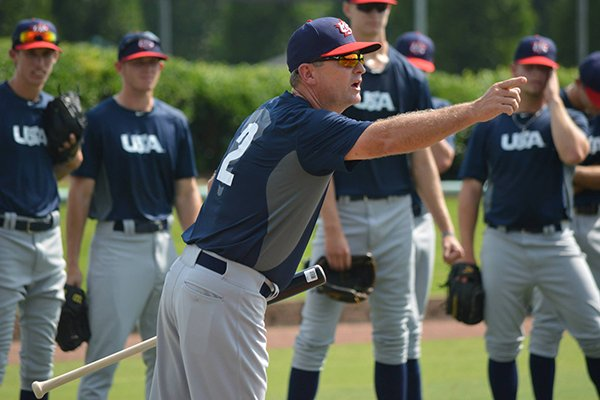 Dave Van Horn works with players during a practice June 19, 2014 in Cary, N.C.