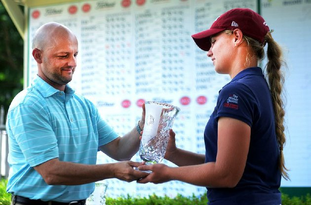 chloe-horton-right-of-miami-receives-her-trophy-thursday-after-winning-the-stacy-lewis-open-in-rogers-horton-defeated-clarie-cameron-of-martinsville-ind-by-two-strokes