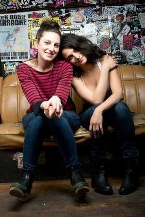Gillian Robespierre (left), writer and director of Obvious Child, poses with the film's star, former Saturday Night Live cast member Jenny Slate, on the film's set.