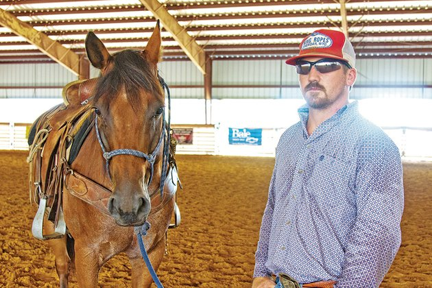 chism-riddle-arena-supervisor-stands-with-one-of-his-horses-at-crossroads-cowboy-church-and-two-bar-two-arena-in-el-paso-the-church-will-host-its-first-ranch-rodeo-on-saturday