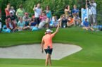 Stacy Lewis calls the hogs with fans as she approaches the 17th green Friday afternoon during the first round of the Walmart NW Arkansas Championship Presented by P&G at Pinnacle Country Club in Rogers.