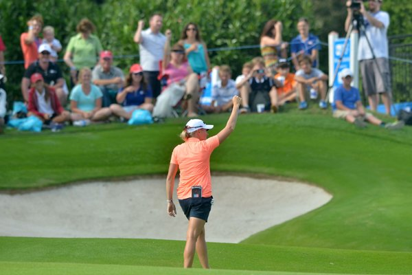 stacy-lewis-calls-the-hogs-with-fans-as-she-approaches-the-17th-green-friday-afternoon-during-the-first-round-of-the-walmart-nw-arkansas-championship-presented-by-pg-at-pinnacle-country-club-in-rogers