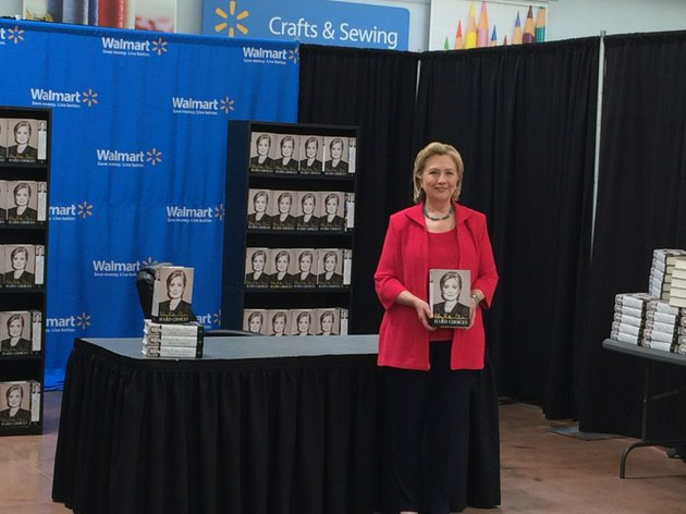 hillary-clinton-poses-with-her-new-book-hard-choices-on-friday-june-27-2014-at-a-west-little-rock-wal-mart