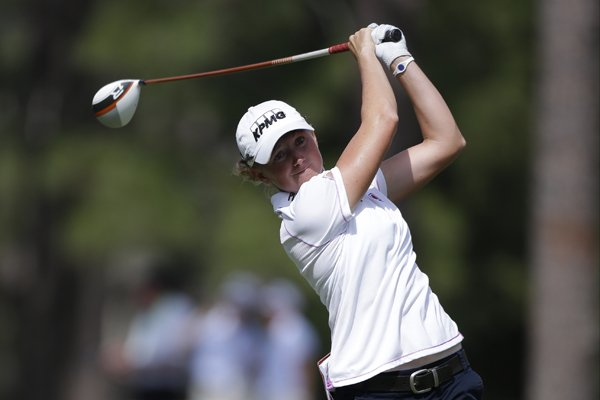 Stacy Lewis hits her tee shot on the 18th hole during the final round of the U.S. Women's Open golf tournament in Pinehurst, N.C., Sunday, June 22, 2014. (AP Photo/Bob Leverone)