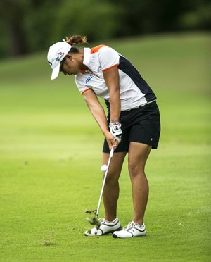 Lydia Ko, of New Zealand, hits from the seventh fairway during the first round of the NW Arkansas Championship golf tournament on Friday, June 27, 2014, in Rogers, Ark. (AP Photo/Beth Hall)