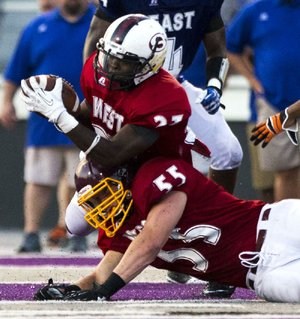 Arkansas Democrat-Gazette/MELISSA SUE GERRITS - 06/27/2014 -  West's Qua Rose snags an interception and struggles to keep to his feet with team mate Chris Eastburn defending during the High School All Star football game June 27, 2014 at UCA in Conway.