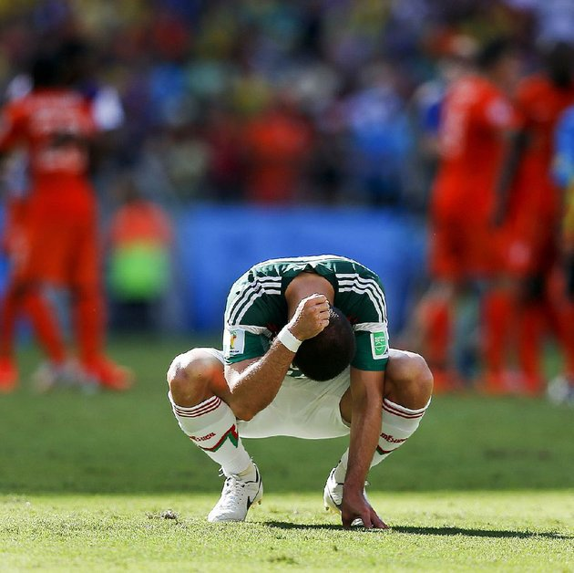 mexicos-javier-hernandez-punches-the-ground-after-the-netherlands-defeated-mexico-2-1-to-advance-to-the-quarterfinals-during-the-world-cup-round-of-16-soccer-match-between-the-netherlands-and-mexico-at-the-arena-castelao-in-fortaleza-brazil-sunday-june-29-2014-ap-photoeduardo-verdugo