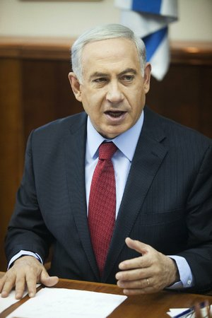Israeli Prime Minister Benjamin Netanyahu speaks during a cabinet meeting in Jerusalem, Sunday, June 29, 2014. (AP Photo/Dan Balilty, Pool)