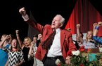 Frank Broyles, surrounded by his family, calls the hogs to close the evening during the 'Coach's Quarter: A Celebration of Coach Broyles' Life and Career' banquet at the John Q Hammons Center in Rogers on Saturday, June 7, 2014.
