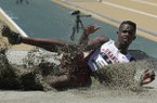 Jarrion Lawson lands in the pit during the men's long jump at the U.S. outdoor track and field championships, Sunday, June 29, 2014, in Sacramento, Calif. Lawson placed second behind first place finisher Jeffery Henderson. (AP Photo/Rich Pedroncelli)