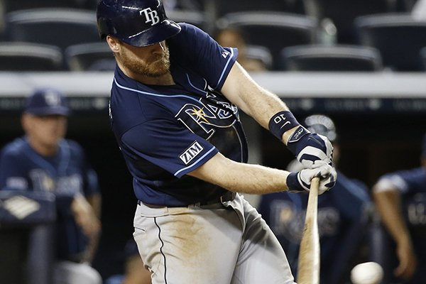 Tampa Bay Rays Logan Forsythe hits a 12th-inning, game-winning, RBI single in the Rays 4-3 victory over the New York Yankees in a baseball game at Yankee Stadium in New York, Monday, June 30, 2014. (AP Photo/Kathy Willens)