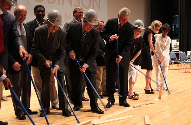 officials-including-arkansas-gov-mike-beebe-and-little-rock-mayor-mark-stodola-pry-boards-from-the-robinson-center-stage-in-a-ceremony-marking-the-beginning-of-a-26-month-renovation