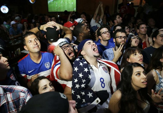 us-soccer-fans-at-the-crown-anchor-british-pub-in-las-vegas-react-tuesday-to-a-missed-opportunity-by-the-americans-during-their-world-cup-soccer-match-against-belgium-us-soccer-fans-including-the-president-gathered-in-front-of-tvs-in-bars-city-parks-stadiums-and-at-their-work-places-to-watch-the-afternoon-match