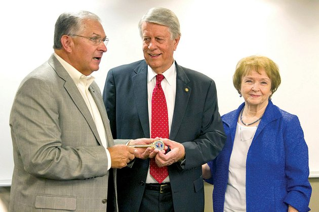 from-left-searcy-mayor-david-morris-presents-retiring-asu-searcy-vice-chancellor-don-harlan-and-his-wife-mary-a-key-to-the-city