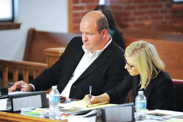STAFF PHOTO ANDY SHUPE Josh Melton, left, sits alongside attorney Courtney Clive during his trial Tuesday at the Washington County Courthouse in Fayetteville.