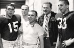 Frank Broyles stands with his players following an undated game.