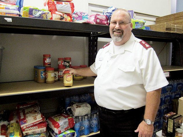 maj-david-robinson-corps-officer-for-the-salvation-army-in-conway-shows-the-sparse-shelves-of-the-organizations-food-pantry-he-said-the-demand-for-food-boxes-has-outpaced-the-supply-and-donations-of-canned-goods-and-other-food-items-are-needed-debbie-hendrix-director-of-social-services-for-the-salvation-army-said-close-to-100-food-boxes-are-given-out-each-week-donations-may-be-taken-to-the-salvation-army-office-in-the-north-plaza-shopping-center-2125-harkrider-st-suite-12-from-8-am-to-noon-and-from-1-5-pm-monday-through-friday