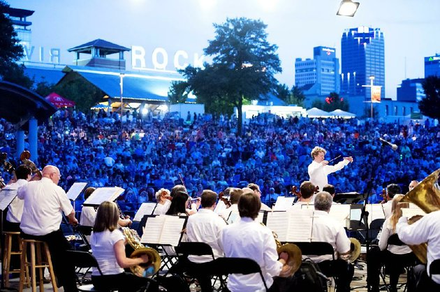 philip-mann-conducts-the-arkansas-symphony-orchestra-for-last-years-pops-on-the-river-this-years-concert-will-incorporate-a-patriotic-singalong-and-for-the-first-time-a-joint-symphony-fireworks-performance