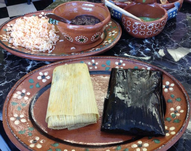 a-combination-plate-featuring-verde-right-and-oaxaqueno-tamales-and-two-sides-shown-here-rice-and-beans-is-499-at-tamalittle-in-little-rock