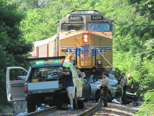 a-child-was-killed-and-three-people-injured-in-a-collision-between-a-train-and-a-vehicle
