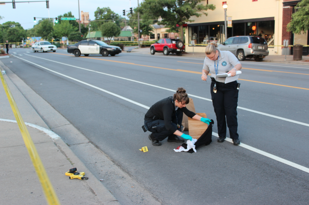 little-rock-police-department-crime-scene-specialists-rachel-carver-left-and-terra-lucas-work-the-scene-thursday-july-3-2014-of-an-early-morning-shooting-on-south-main-street-in-little-rock