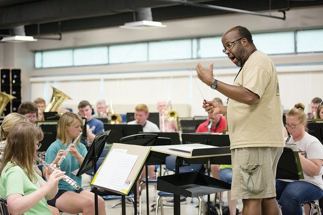 brantley-douglas-directs-a-piece-monday-night-at-a-rehearsal-of-the-conway-community-band-made-up-of-musicians-from-central-arkansas-the-group-will-perform-its-fourth-of-july-program-at-730-pm-today-in-simon-park-on-front-street-in-downtown-conway-the-106th-army-band-five-star-brass-quintet-will-make-a-special-appearance