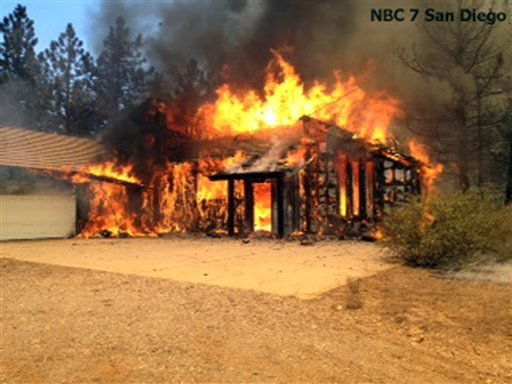 in-this-still-frame-from-video-provided-by-knsd-tv-a-home-is-fully-involved-in-flames-as-crews-scrambled-to-corral-a-wildfire-that-burned-two-homes-near-the-san-diego-county-mountain-town-of-julian-in-southern-california-thursday-july-3-2014-the-blaze-erupted-around-1030-am-and-prompted-the-mandatory-evacuation-of-200-homes-firefighters-attacked-the-150-acre-blaze-in-the-air-and-on-the-ground-the-fire-destroyed-two-homes-and-an-outbuilding-and-was-15-percent-contained-at-nightfall-state-fire-capt-kendal-bortisser-said