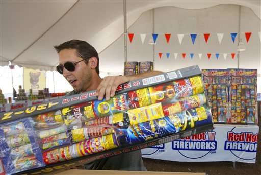 in-this-photo-taken-on-wednesday-july-2-2014-brian-herrman-a-co-owner-of-red-hot-fireworks-in-phoenix-puts-out-new-items-on-the-shelves-as-sales-of-fireworks-have-been-brisk-at-the-store-although-phoenix-has-gone-a-full-120-days-without-any-measurable-precipitation-there-has-not-been-any-serious-effort-in-the-drought-stricken-states-to-restrict-fireworks-arizona-actually-loosened-its-restrictions-this-year-and-allowed-residents-of-the-two-most-populated-cities-to-set-off-fireworks-around-independence-day