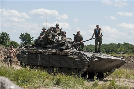 ukrainian-troops-atop-an-apc-at-a-checkpoint-near-slovyansk-eastern-ukraine-saturday-july-5-2014-ukraines-forces-claimed-a-significant-success-against-pro-russian-insurgents-on-saturday-chasing-them-from-one-of-their-strongholds-in-the-embattled-east-of-the-country-rebels-fleeing-from-the-city-of-slovyansk-vowed-to-regroup-elsewhere-and-fight-on