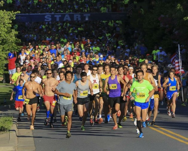 arkansas-democrat-gazettestaton-breidenthal-7414-runners-leave-the-starting-line-to-begin-the-firecracker-fast-5k-saturday-morning