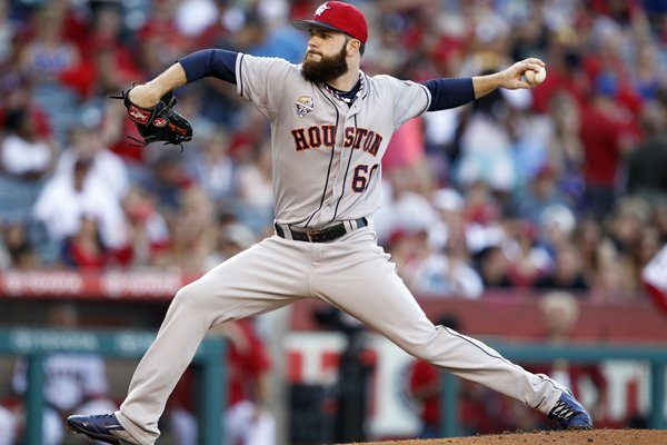 Houston Astros starting pitcher Dallas Keuchel throws against the Los Angeles Angels in the first inning of a baseball game on Friday, July 4, 2014, in Anaheim, Calif. (AP Photo/Alex Gallardo)
