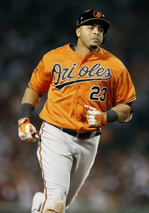 Baltimore Orioles' Nelson Cruz rounds third base on a solo home run in the fifth inning of the second game of a baseball doubleheader against the Boston Red Sox in Boston, Saturday, July 5, 2014. (AP Photo/Michael Dwyer)