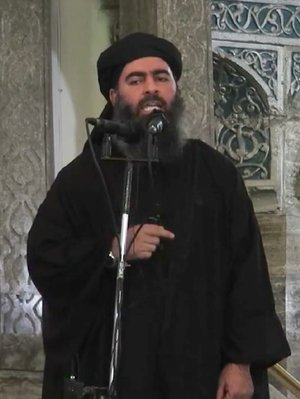 This image taken from the website of an extremist group calling itself the Islamic State purportedly shows the group's leader, Abu Bakr al-Baghdadi, delivering a sermon Saturday in Iraq.