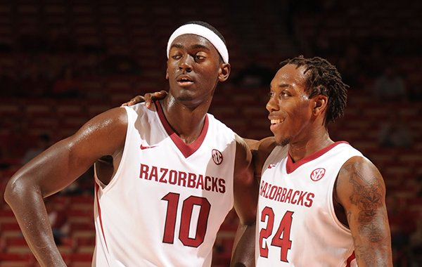Arkansas freshman forward Bobby Portis, left, shares a laugh with sophomore guard Michael Qualls during the second half of play against Northeastern State Tuesday, Nov. 5, 2013, in Bud Walton Arena in Fayetteville.