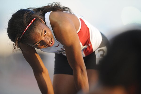 Arkansas freshman Regine Williams checks her time on the scoreboard after finishing in the 200 meters during the third day of the NCAA Outdoor Track and Field West Preliminary Meet at John McDonnell Field in Fayetteville.