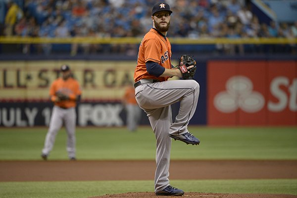 Houston Astros starting pitcher Dallas Keuchel, right, goes through his windup during the first inning of a baseball game against the Tampa Bay Rays in St. Petersburg, Fla., Sunday, June 22, 2014.(AP Photo/Phelan M. Ebenhack)