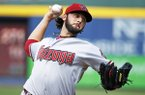 Arizona Diamondbacks starting pitcher Mike Bolsinger works in the second inning of a baseball game against the Atlanta Braves in Atlanta, Saturday, July 5, 2014. (AP Photo/John Bazemore)