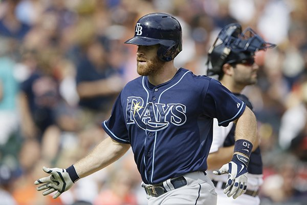 Tampa Bay Rays' Logan Forsythe arrives at home after his solo home run during the fifth inning of a baseball game against the Detroit Tigers in Detroit, Saturday, July 5, 2014. (AP Photo/Carlos Osorio)