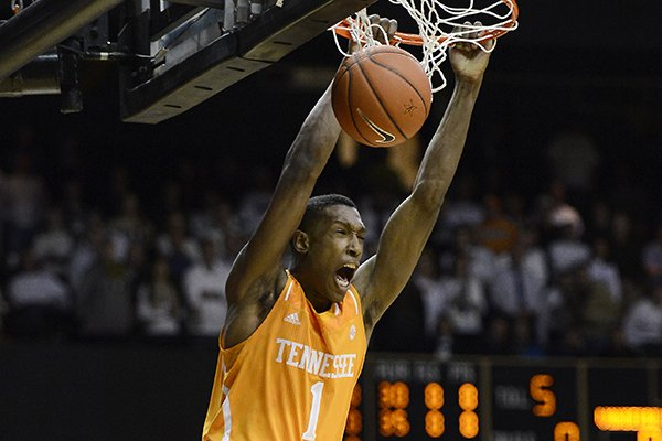 In this Feb. 5, 2014, file photo, Tennessee guard Josh Richardson (1) opens the game with a breakaway dunk in the first half of an NCAA college basketball game against Vanderbilt, in Nashville, Tenn. Richardson is the lone returning starter and one of only four returning scholarship players from the Tennessee team that went 24-13 and reached an NCAA regional semifinal last season. (AP Photo/Mark Zaleski, File)