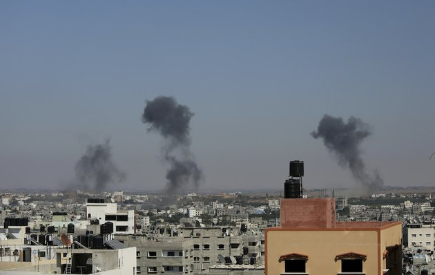 smoke-rises-after-an-israeli-missile-strike-in-gaza-city-on-tuesday-july-8-2014-the-israeli-military-launched-what-could-be-a-long-term-offensive-against-the-hamas-ruled-gaza-strip-on-tuesday-striking-nearly-100-sites-in-gaza-and-mobilizing-troops-for-a-possible-ground-invasion-aimed-at-stopping-a-heavy-barrage-of-rocket-attacks-against-israel