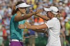 In this June 22, 2014, file photo, Michelle Wie, left, is embraced by runner-up Stacy Lewis after winning the U.S. Women's Open golf tournament in Pinehurst, N.C. One is tall and powerful, the other compact and precise. Wie and Lewis, for all their differences, have become fast friends in golf. They're also leading an American revival, which resumes this week at Royal Birkdale. (AP Photo/Chuck Burton, File)